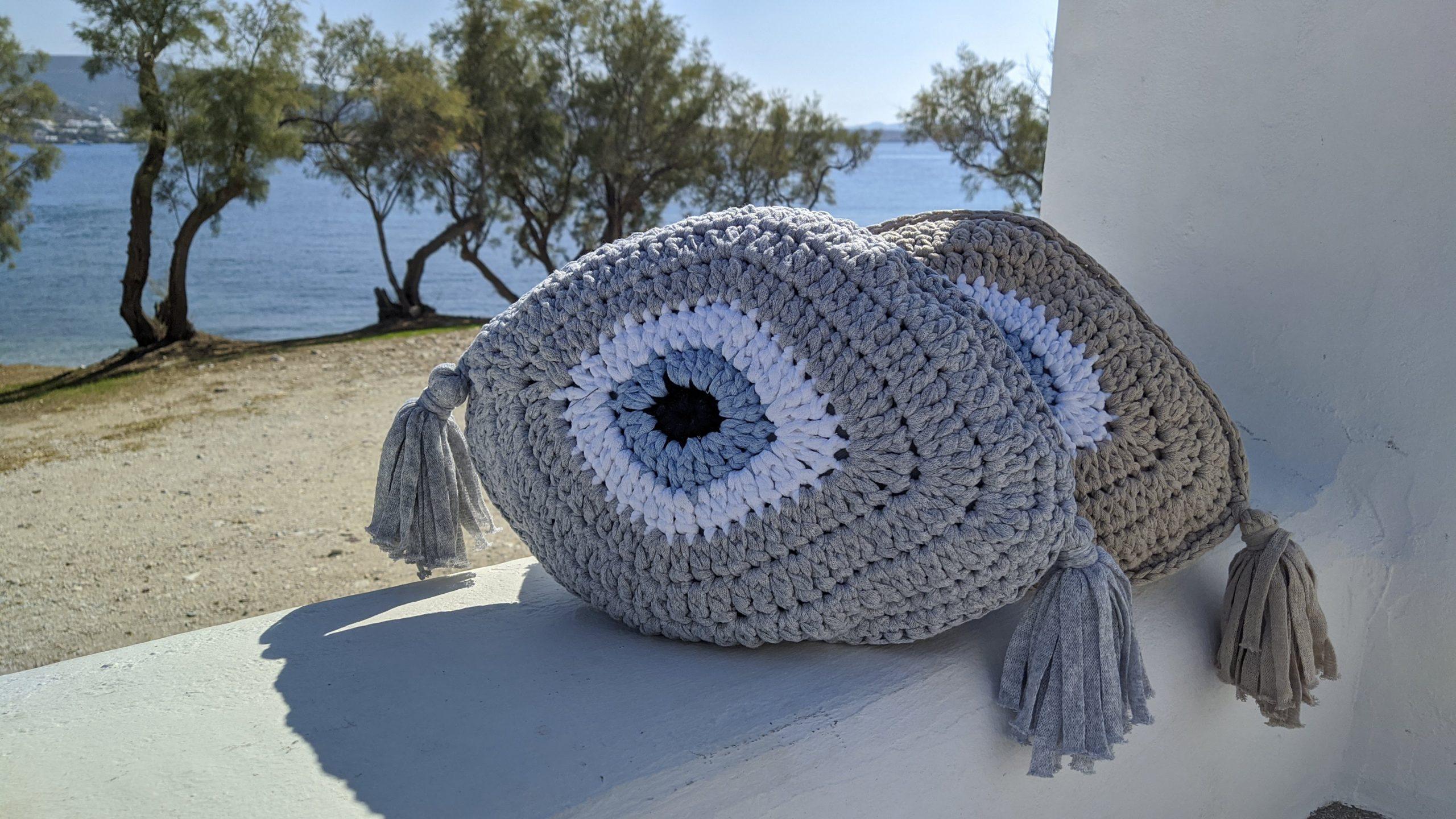 evil eye cushions with tassel