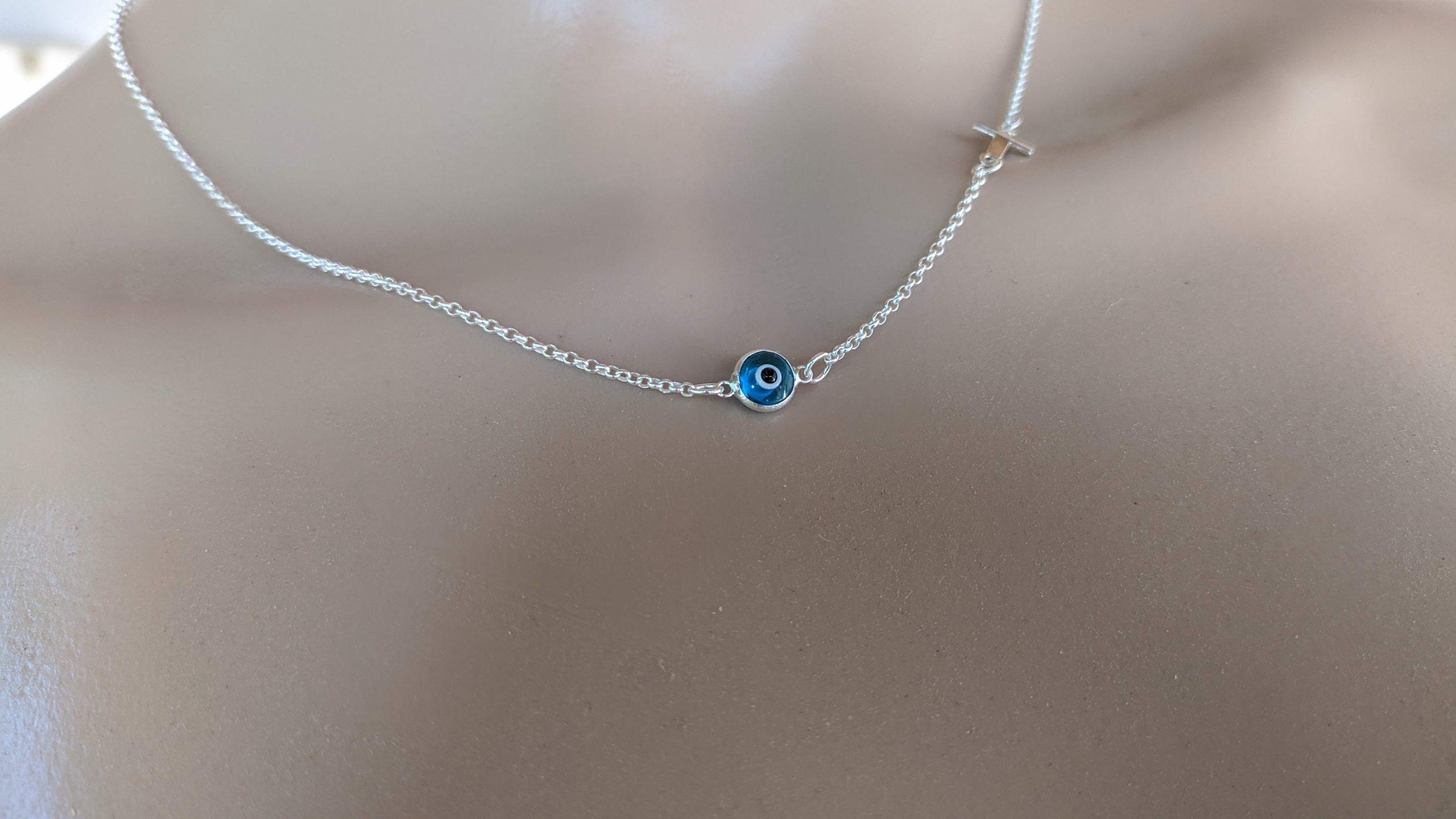 evil eye cross necklace in sterling silver